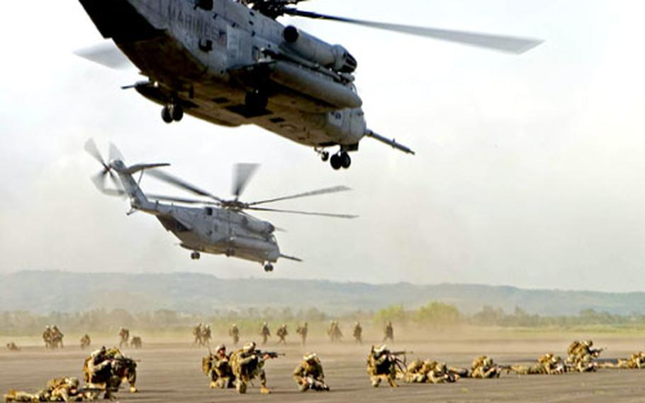 U.S. Marines and sailors from Battalion Landing Team 1st Battalion, 5th Marine Regiment of the 31st Marine Expeditionary Unit, conduct a long range helicopter-borne raid at Basa Air Base in the Philippines Sunday.
