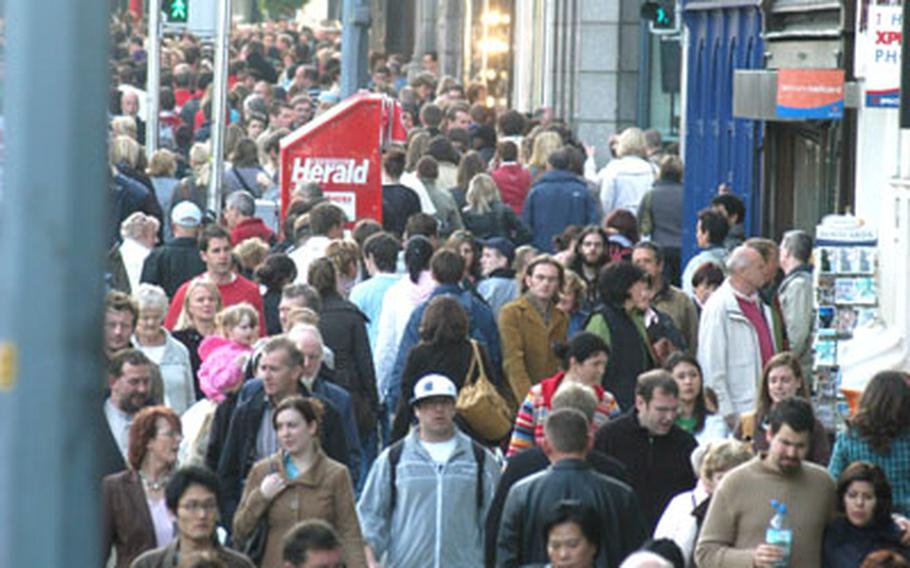 Hordes of tourists, shoppers and local Dubliners march along Suffolk Street, which is one of the main shopping districts in the city.