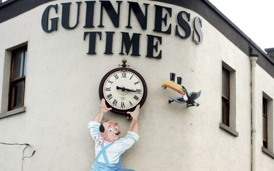 A sign advertising Guinness beer adorns the outside of a pub in Dublin.