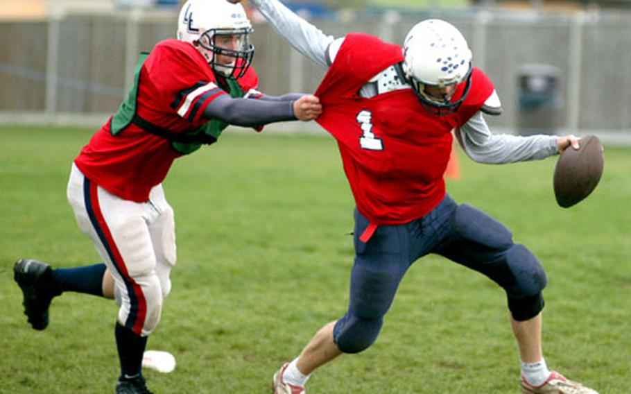 Drake Tucker snatches up quarterback Ben Green during a drill last week before Lakenheath's game against K-town.
