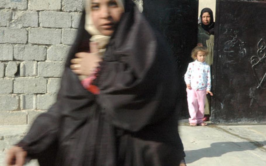 Locals in Hawijah are wary of the American presence. Women and children, as pictured in this 2005 photo, have yelled at passing American patrols. The small, somewhat isolated town is home to intense violence.