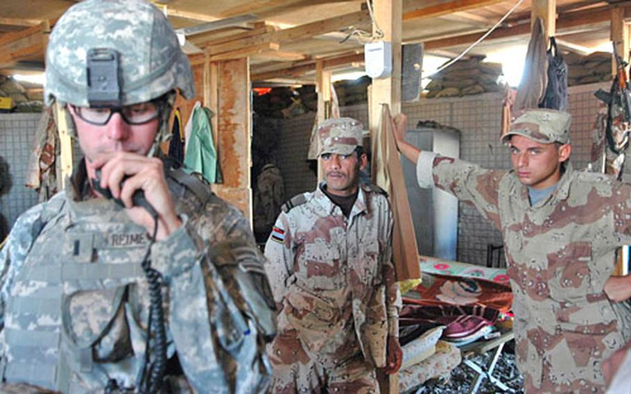 1st Lt. Seth Reimers responds to a call about a roadside bomb in Mahmudiyah, Iraq. Reimers and several Iraqi army soldiers say that sectarian militias are gaining strength in the region.