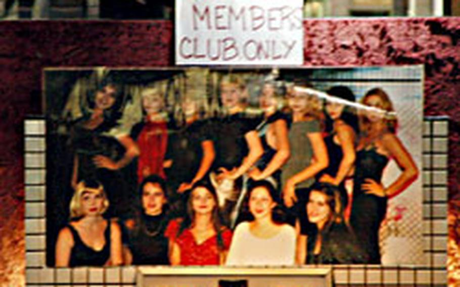 """Foreign women like the Russians in the picture display come to Japan to work in """"gentlemen's clubs."""""""