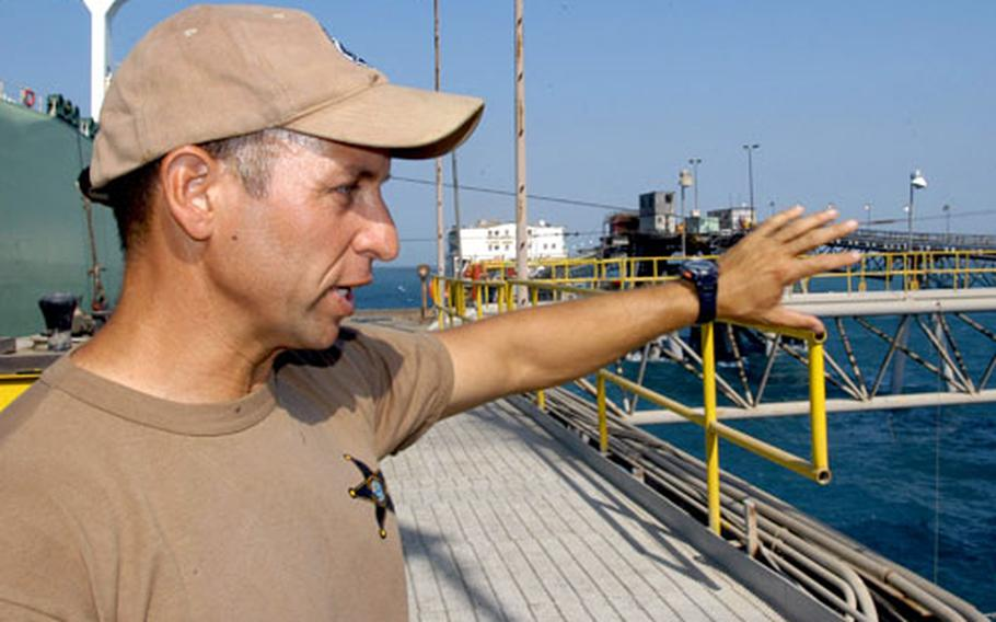 Navy Lt. Aaron Bergman, officer in charge of Mobile Security Detachment 73, looks out over the Basra oil terminal. If something happened to the terminal, Bergman says, Iraq's economy might not survive.