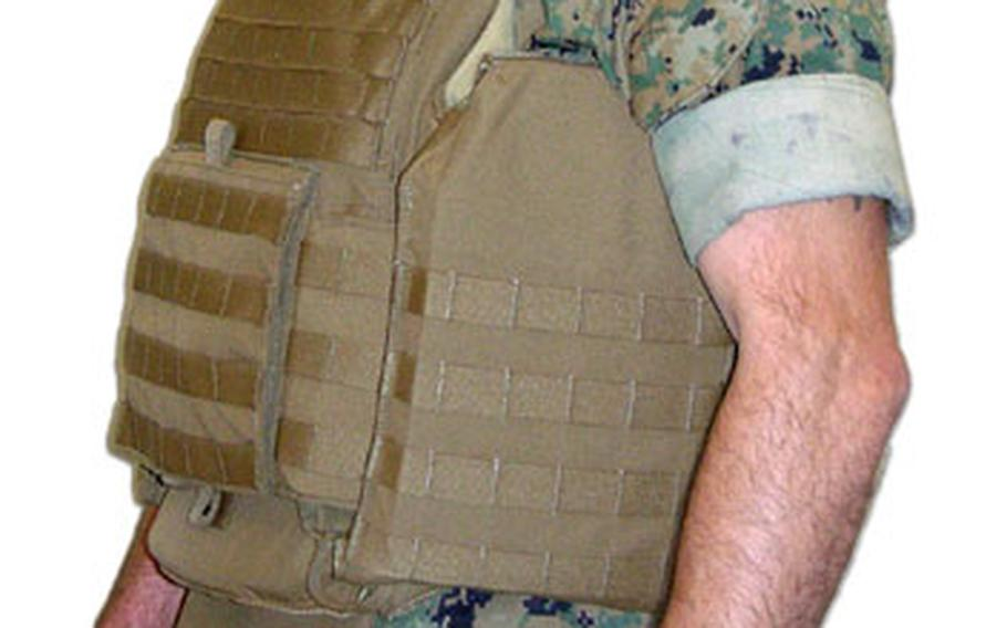The Modular Tactical Vests, while slightly heavier, are said to fit better, and will provide more protection to the side torso, lower back and kidney area, according to Marine officials.