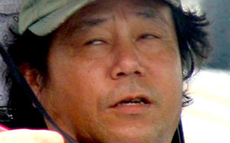"""""""I have not had any horrifying or dangerous experiences while at work,"""" said Camp Foster cabbie Yukio Kawamitsu, 56."""