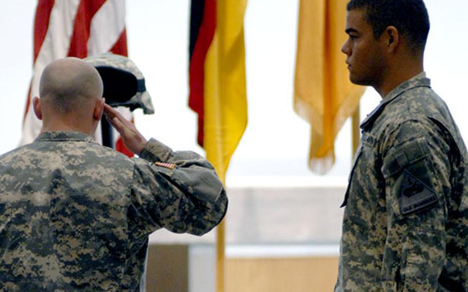 A soldier pays his respects to Spc. Jose Perez during a memorial ceremony at Baumholder on Monday.