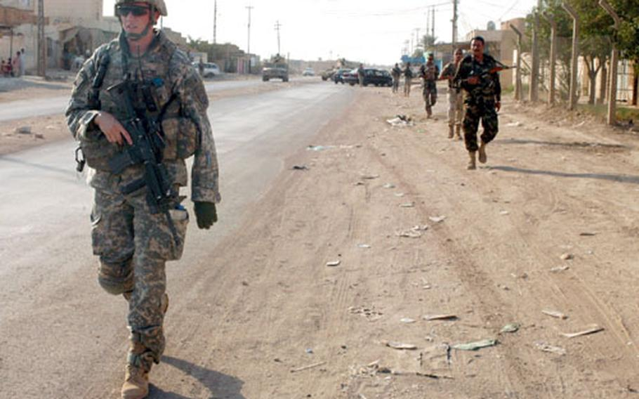 First Lt. Brennan Goltry leads a joint patrol of U.S. soldiers from Company C, 2nd Battalion, 505th Parachute Infantry Regiment and members of the 3rd Battalion, 3rd Brigade 1st Iraqi National Police Division on Friday in downtown Samarra.