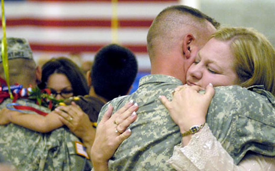 Angie Poore welcomes home her husband, Sgt. 1st Class Raymond Poore, during a ceremony Monday in Baumholder, Germany.