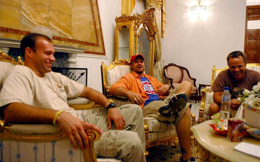 From left, comedians Keith Alberstadt, Dave Mishevitz and Tom Foss relax at Saddam Hussein's former pleasure palace in Baghdad. The three have found plenty to laugh about amid the seriousness of Iraq.