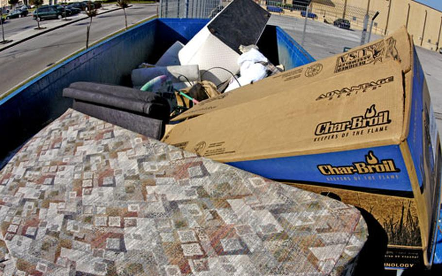A recyclable cardboard box sits in the Dumpster set aside to collect bulk garbage, a no-no that contributes to the problem of trash in the region. U.S. residents living in Naples, Italy, can help by properly disposing of trash and recycling, officials said.