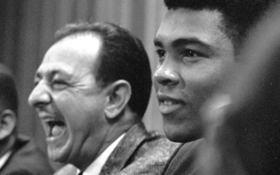 Angelo Dundee with Muhammad Ali at a 196 press conference in Frankfurt, Germany.