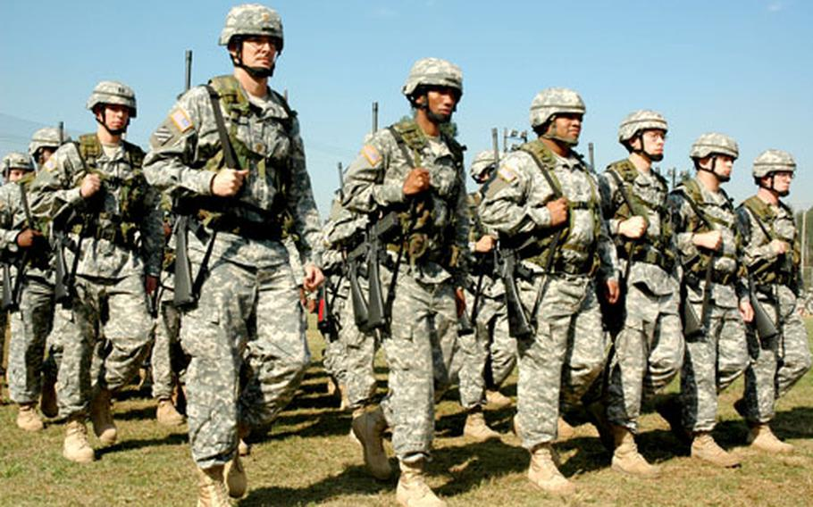 Soldiers with the 19th Sustainment Command (Expeditionary) march Wednesday morning during the change-of-command ceremony.