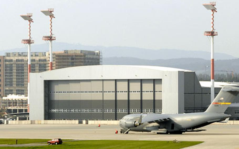 A C-17 sits outside Ramstein Air Base's new C-5 hangar.