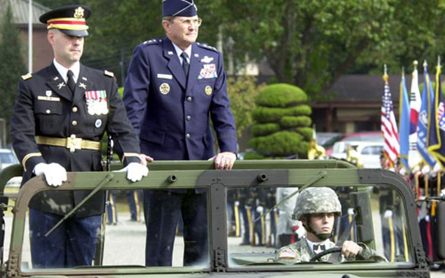 Air Force Lt. Gen. Garry R. Trexler, right, and U.N. Honor Guard company commander Capt. Brett Wiersma inspect the troops during a farewell ceremony for Trexler on Thursday at Yongsan Garrison, South Korea. Trexler is retiring after 35 years of service.