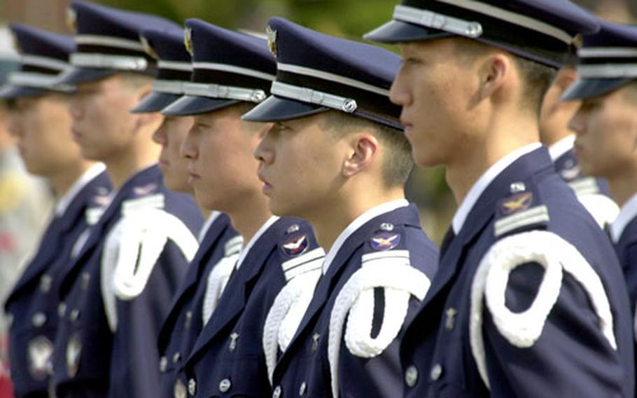 Members of the United Nations honor guard stand at attention during the farewell ceremony for U.S. Air Force Lt. Gen. Garry R. Trexler.