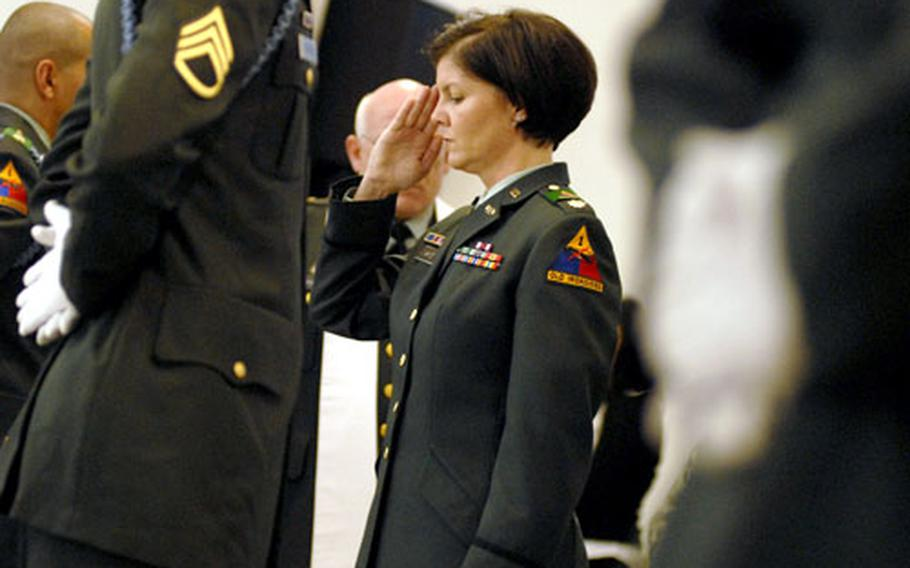 Maj. Jeanine White, the brigade rear detachment commander, salutes to honor Staff Sgt. Kevin Witte at the end of the memorial ceremony on Friday.
