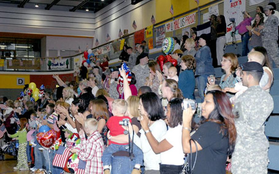 Friends and family members of the soldiers in the Bamberg, Germany-based 54th Engineer Battalion cheer their returning heroes Friday at the Freedom Fitness Facility on Warner Barracks. The 54th just completed a yearlong deployment to Ramadi, Iraq.