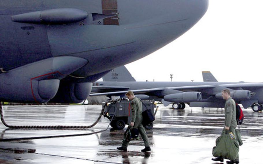 Rain, like the heavy weather above, is just one of the challenges that have confronted the 23rd Expeditionary Aircraft Maintenance Unit. The unit has been deployed from Minot Air Force Base, N.D., to Andersen Air Force Base, Guam, to maintain six aging B-52s.