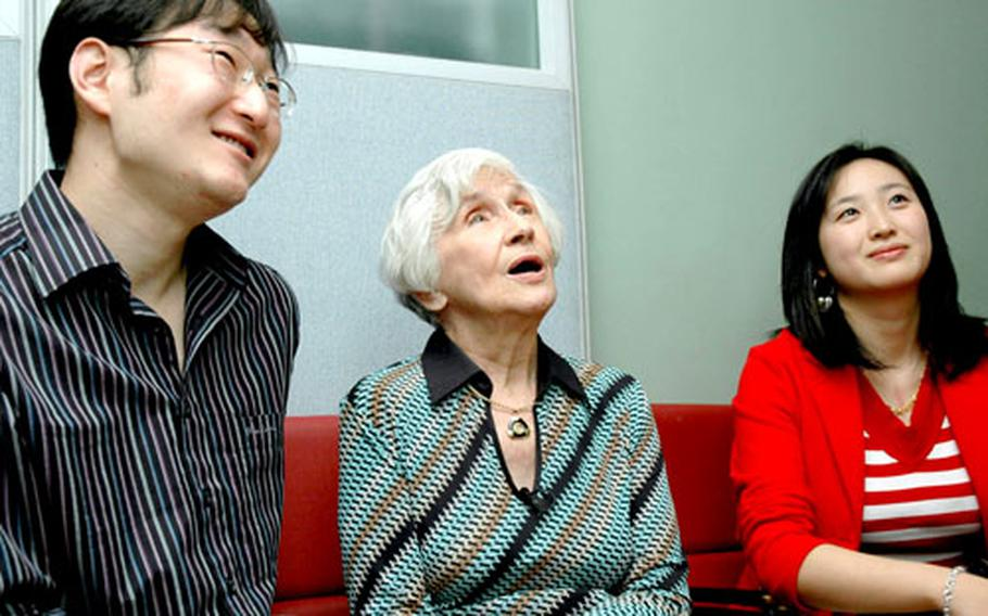 Harriet Hodges, 89, talks with some of the South Korean children — now grown with children of their own — for whom she helped get life-saviing heart surgery in the States.