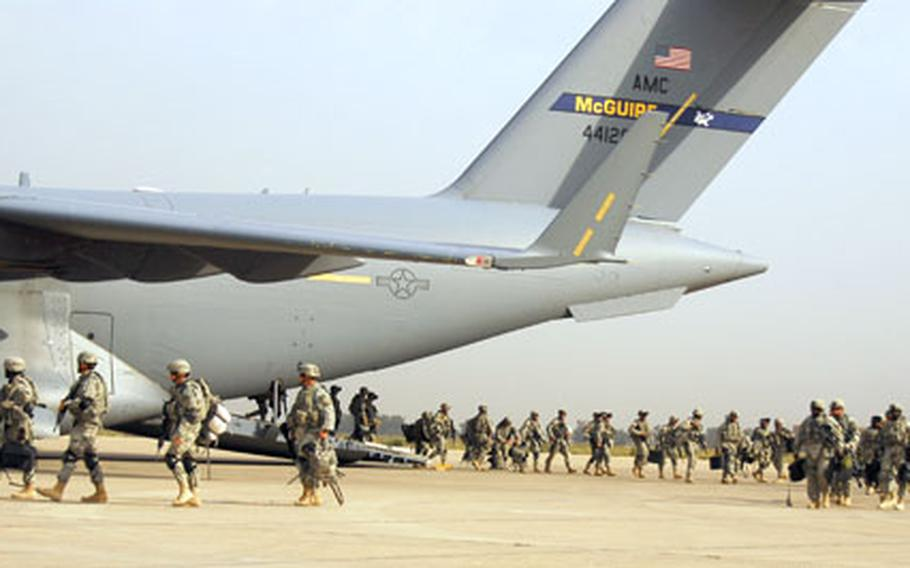 Soldiers from 2nd Brigade Combat Team, 1st Infantry Division, Multi-National Division–Baghdad, exit from the ramp of an Air Force C-17 onto the flight line at Baghdad International Airport after arriving from Kuwait on Oct. 19.