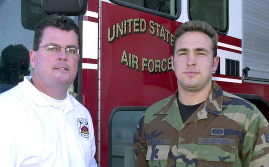 Airman 1st Class Christopher Gerdes, right, DOD military firefighter of the year, with Paul Erickson, Air Force civilian firefighter of the year.
