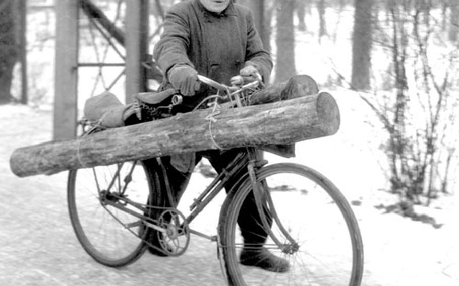 A Berliner uses his bike to carry home a piece of firewood to supplement the meager coal ratiion.