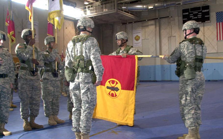 Soldiers from the 210th Fires Brigade perform a re-flagging ceremony at Camp Casey, South Korea, on Wednesday morning.