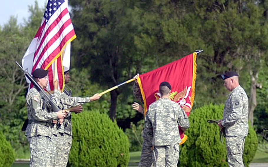 Soldiers with 1st Battalion, 1st Air Defense Artillery uncase the unit's colors for the first time on Okinawa during an activation ceremony at the 18 Wing's headquarters on Kadena Air Base on Thursday.