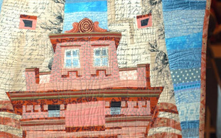 Heidelberg's old bridge and gate, built from 1786 to 1788, never looked quite the way it does here in one of KristinLaFlamme's art quilts.