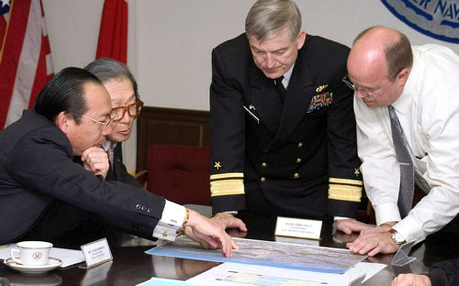 Yokosuka's second Rental Partnership Program agreement was struck Nov. 14 when Commander Naval Forces Japan Rear Adm. James D. Kelly, center, met with Takara House Corporation officials.