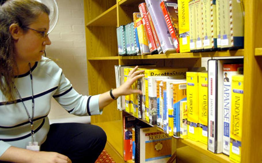 RAF Mildenhall librarian Michelle DeLeo searches for a Rosetta Stone language program at the base library recently. The facility has a number of the programs on hand, and they now also are offered for free online through USAFE libraries.