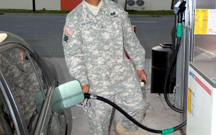 Sgt. Marquis Dodson, squad leader, 240th Quartermaster Company, fills his Honda Accord at a shoppette/gas station Thursday in Bamberg, Germany.