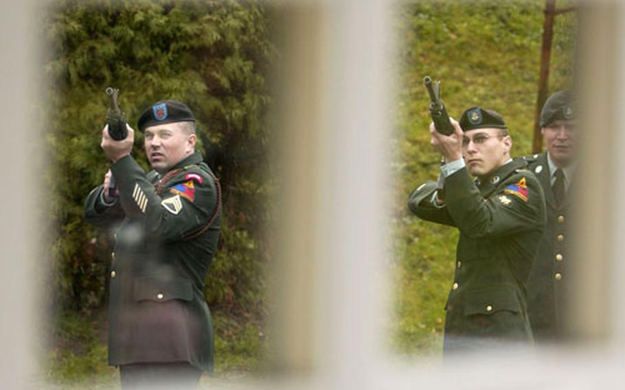 Staff Sgt. Daniel Carnahan from the 40th Engineering Battalion, left, and Spc. Christopher Wyatt from 1st Battalion, 6th Infantry Regiment fire a volley at the end of a memorial ceremony held in honor of Cpl. Jon-Eric Loney at Baumholder chapel on Monday.