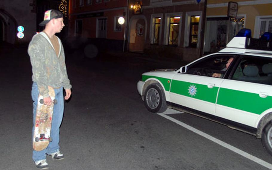 At midnight Friday, the streets of Vilseck were almost deserted except for a few soldiers wandering between the town's three bars and roving German police quick to warn skateboarders that the Marketplatz is off-limits to their sport.