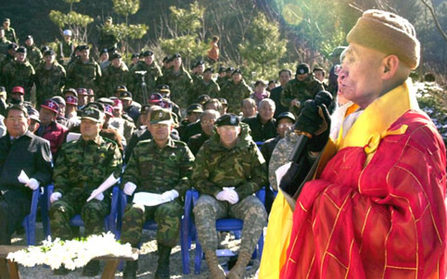 Buddhist chief monk Lee Doil says a blessing before the unveiling of a memorial to the 2nd Infantry Division's 1st Battalion, 72nd Armor Regiment, in Chun-an-ri Monday. During the Battle of Kapyong in 1951, the unit fought off a North Korean and Chinese offensive while completely surrounded. Doil helped the the unit and the United Nations allies during the fight while living in a temple not far from the memorial. He still lives there today.