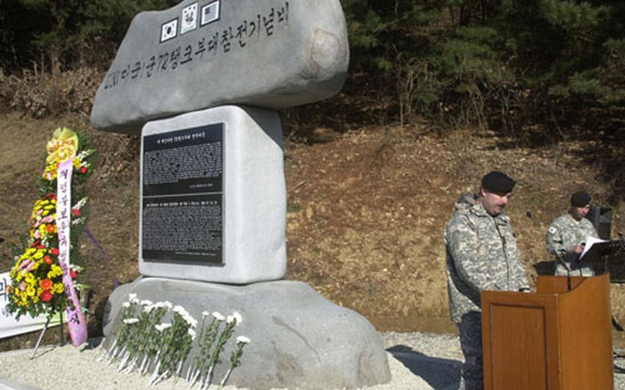Lt. Col. Thomas Isom, commander of the 2nd Infantry Division's 1st Battalion, speaks at Monday's ceremony in Chun-an-ri.