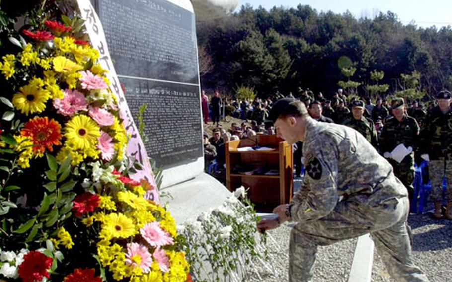 Capt. Patrick Stone, Alpha Company commander of the 2nd Infantry Division's 1st Battalion, 72nd Armor Regiment, honors past comrades who fought while surrounded at the Battle of Kapyong during a memorial dedication to the unit in Chun-an-ri Monday.