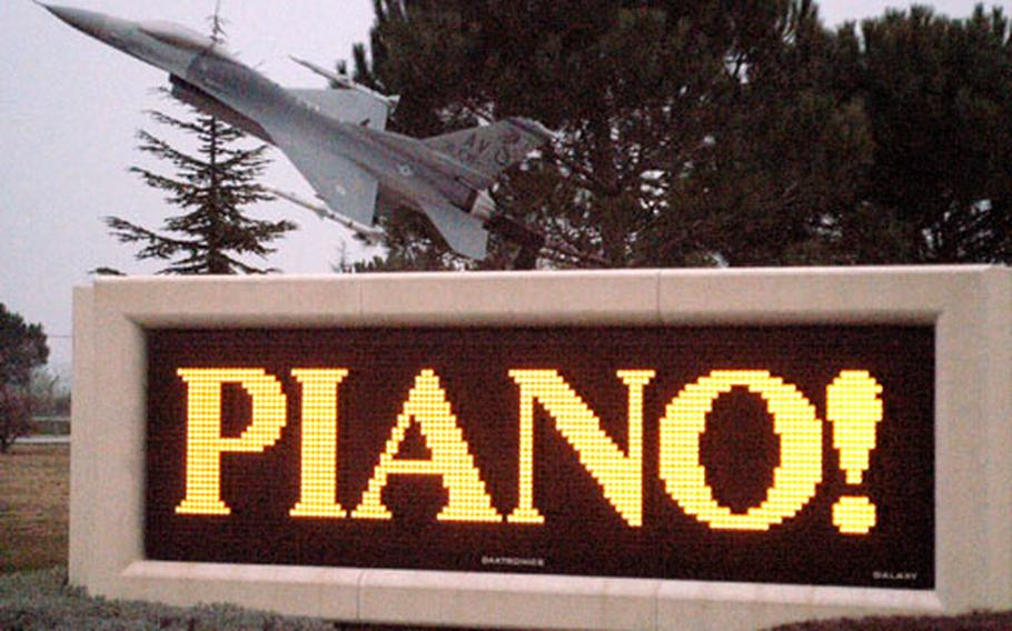 """This sign at the entrance to Aviano Air Base isn't referring to a musical instrument. Piano means """"slow"""" in Italian, and base officials want those stationed in northeastern Italy to drive that way."""