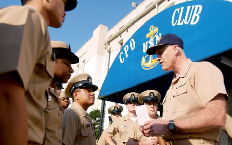 Yokosuka Naval Base command chaplain Cmdr. Bob Freiberg accepts $5,000 for the USS Oneida project from the 2007 class of chief petty officers.
