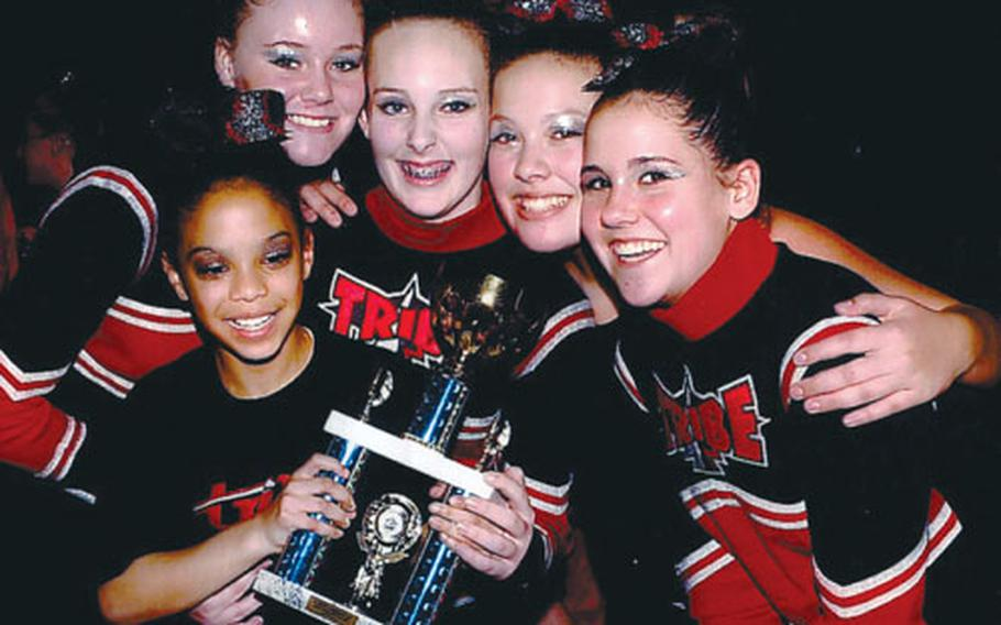 From left, Chayla Walton, Jade Snedeker, Ellie Martin, Mariyah Senter andCheyanne Plewe of the Lakenheath Youth Program's cheerleading squad, the Thunder Birds, pose with one of their trophies at the Winter Wonderland Cheer and Dance Championship in London on Saturday. The junior squad is part of the Tribe, which brought home five top-three finishes in the annual competition.
