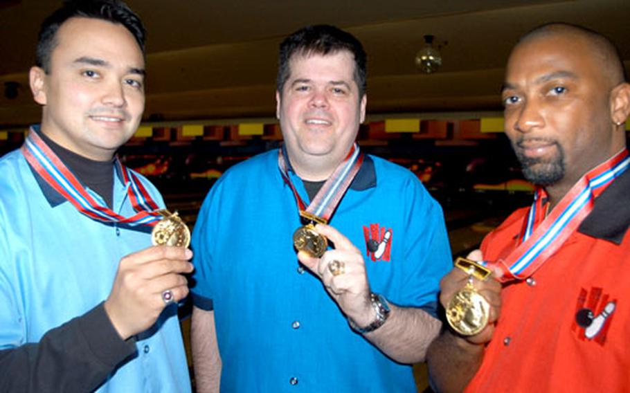 While wearing their championship bowling shirts, Misawa bowlers, from left, Staff Sgt. Shawn Matter, Senior Master Sgt. Joe Carney and Kevin Radford hold up the medals they won for their victory last month at the largest annual bowling tournament in Aomori Prefecture.