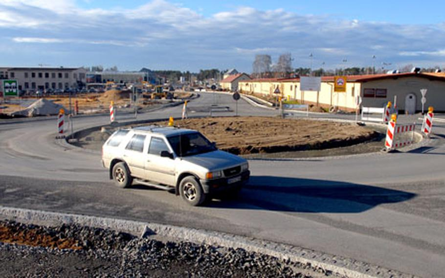 A large turning circle at Grafenwöhr's Main Post with exit roads leading to the training area, Burger King and the new PX was finished this week, relieving local drivers who had faced detours for the past two months. Germany's unseasonably warm weather allowed workers to finish the roadway earlier than expected.