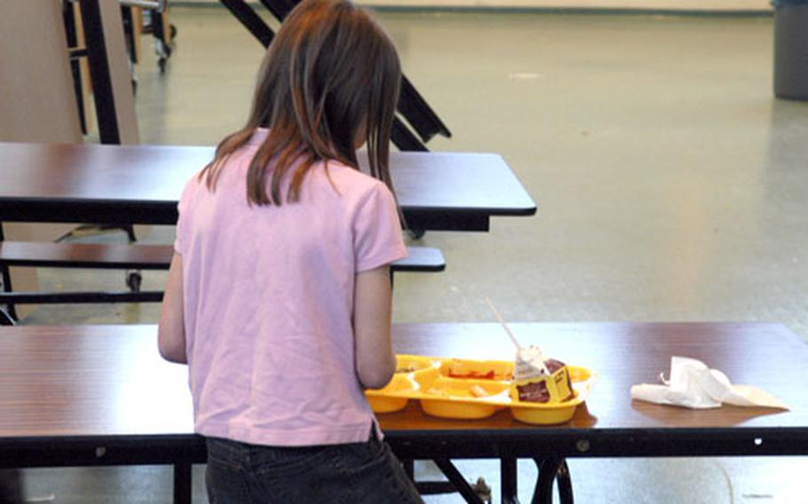 One of the last students to receive her lunch finishes up at Patch Elementary School on Thursday. Principal Robert Allen said he wants to change the current lunch schedule so students won't be late for class. Some students don't receive their meals until there is less than 10 minutes left in their 30-minute lunch break.