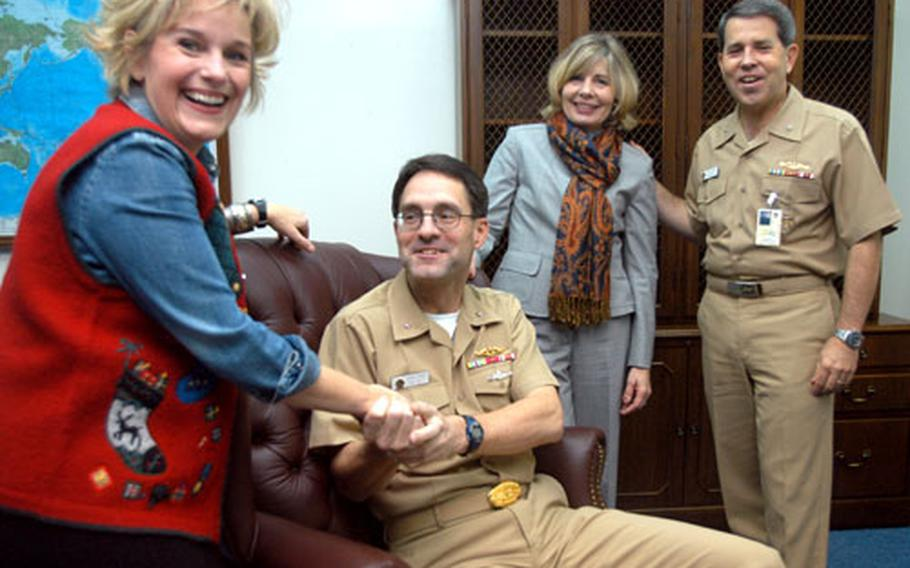 From left, Nonie Bird and her husband Rear Adm. John Bird, seated, will be leaving Yokosuka after Wednesday's change of command ceremony when Rear Adm. Douglas McAneny, far right, takes command of Submarine Group 7. McAneny is accompanied by his wife, Peggy.