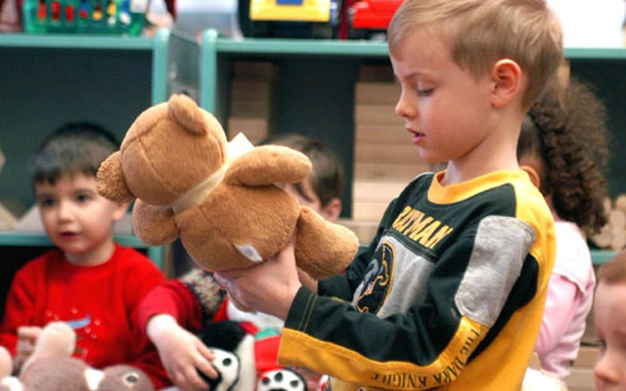 Wiesbaden preschooler Mark Jones bids his bear adieu Wednesday as part of a stuffed animal drive for needy Afghan and Iraqi children. The effort, which concludes Monday, already has led to at least 78 donated furry friends.