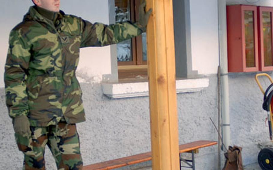 An Alpini relaxes before training at Arabba, Italy on Monday.