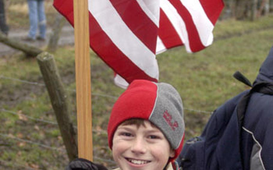 Patrick Gelbach, a Cub Scout from Stuttgart, Germany, carried the American flag during the Battle of the Bulge walk.