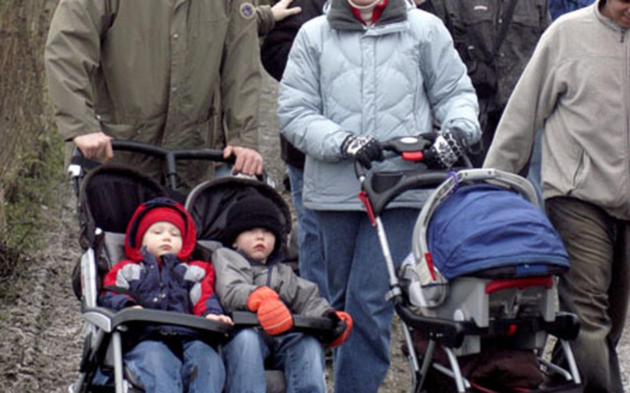 Army Capt. Keith Koistinen, a veterinarian from Stuttgart, Germany, and his wife, Kaarina, pushed strollers through some muddy conditions Saturday during the Battle of the Bulge walk. With them are their children, from left, Lyle, 2, Carson, 3, and Neal, 6 months.