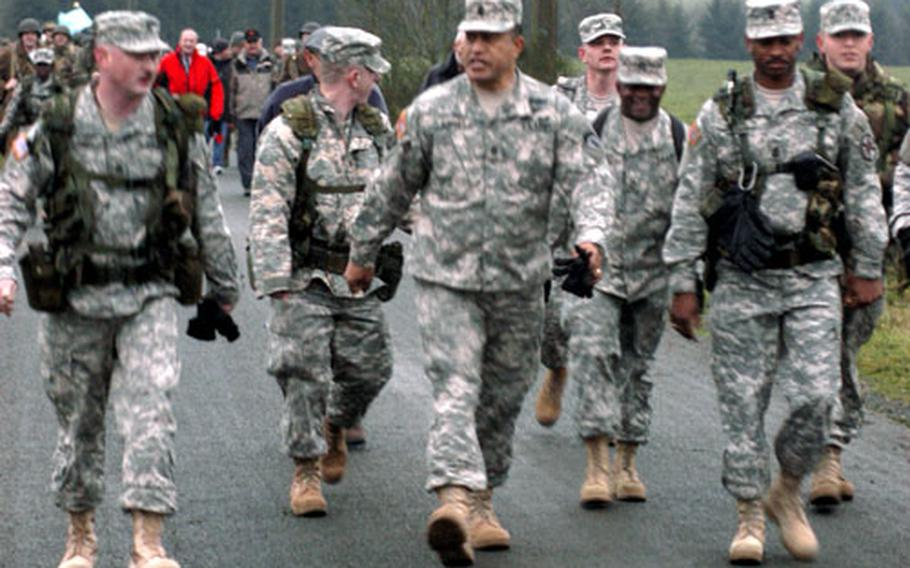 U.S. Army Europe Command Sergeant Major Iuniasolua T. Savusa, center, walks with fellow U.S. Army troops during Saturday's Battle of the Bulge march.